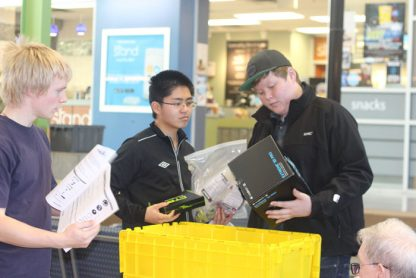 "From left, Thomas Boland, Andrew Chan and Patrick Little inspect ""robot parts"" given to their team at a recent BCIT robotics competition."