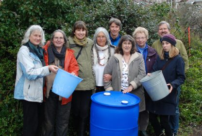 Ready to collect funds drop-by-drop for an additional rainwater storage system at Fraser's Thimble Farms are, from left, landscapers Daphne Taylor and Lorraine Hamilton, water storage expert Sharon Bywater, conservationist Nina Raginsky, Transition Salt Spring past-president Andrew Haigh, salmon enhancement biologist Kathy Reimer, master gardener/author Linda Gilkeson, landscaper Michael Howell and Kristin Peebles of Constant Connection.