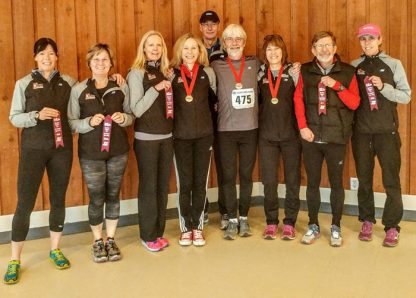 Sneakers running club members with medals and ribbons.