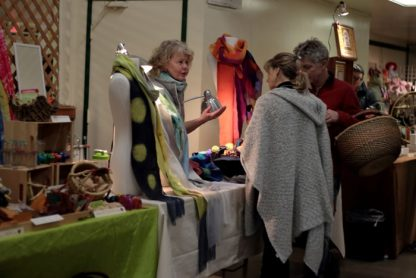 Vendor Ulrieke Benner talks to patrons at last year's Indoor Market at the Salt Spring Farmers' Institute. This year's version is set for Saturday, Feb. 18.