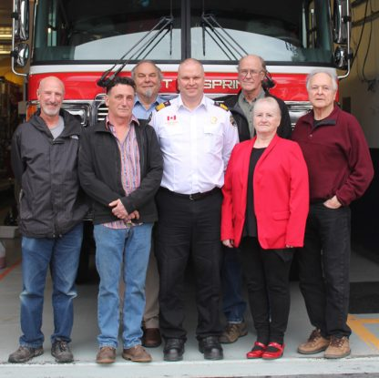Flanking Salt Spring Fire Chief Arjuna George are, from left, Howard Holzapfel, Chris Budd, Mitch Forest, Per Svendsen, MaryLynn Hetherington and Howard Baker.