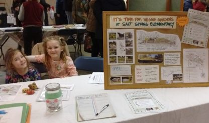 Bryn and Alil'a at the SS Elementary School fundraising table for the school's gardening project at Seedy Saturday.
