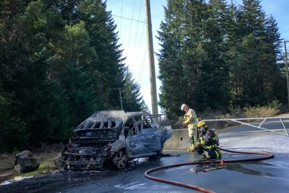 Salt Spring firefighters wrap up work at the scene of a car fire Friday afternoon on Broadwell Road.