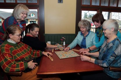 Clockwise from bottom left, Christine Witherspoon, Diane Lugsdin, Oni Freeman, Beth Gessinger, Jill Tarswell and Connie Holmes play Scrabble in preparation for this year's fundraiser for the Stephen Lewis Foundation.