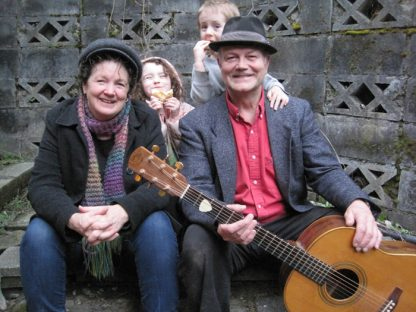 Barb Slater and Kevin Wilkie are the Bread and Roses duo set to perform at Tea a Tempo on April 5. With them in this photo are grandchildren, Ava and Theo eating fresh bread.