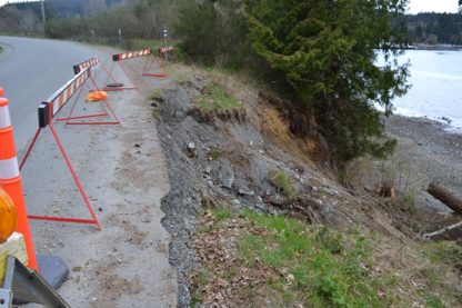 Safety barriers at the site of a major washout on Isabella Point Road.