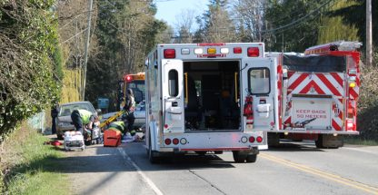 Emergency crews attend to a cyclist hit in the 400 block of Fulford-Ganges Road on Monday afternoon.