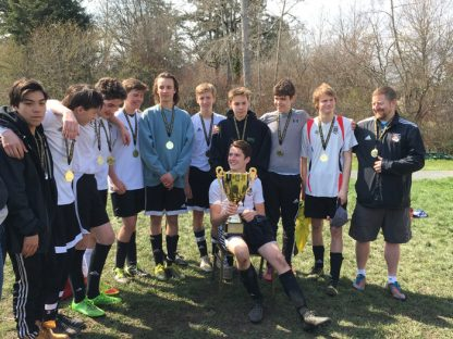 Salt Spring Slayers, the U-18 boys team coached by Colin Walde, show their medals and the Lower Island Soccer Association district cup earned in the final game against Gorge on Sunday.