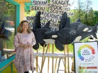 Lisa Lipsett with orca sculptures at Salt Spring Gallery.