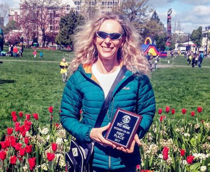 Susan Gordon with her plaque for winning first place in her women'a 55-59 age category at the Times Colonist 10K race.