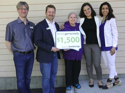 From left, Island Savings rep Travis Dorchak, branch manager Jeff Knutson, Cherie Geauvreau, SWOVA executive director Kiran Dhingra and Volunteer and Community Resources administrator Janine Fernandes-Hayden celebrate Geauvreau's win in the Simple Generosity program, which sees $1,500 donated to SWOVA.
