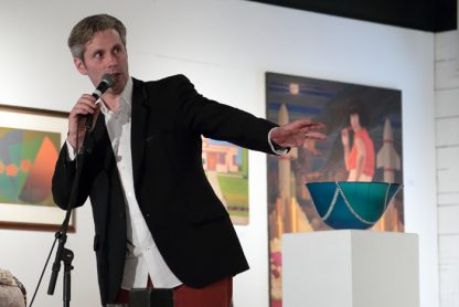 Artist-comedian John Bateman leads a SSNAP art auction in 2015. Bateman is again the live auction MC on Saturday night as part of a May long weekend string of events.